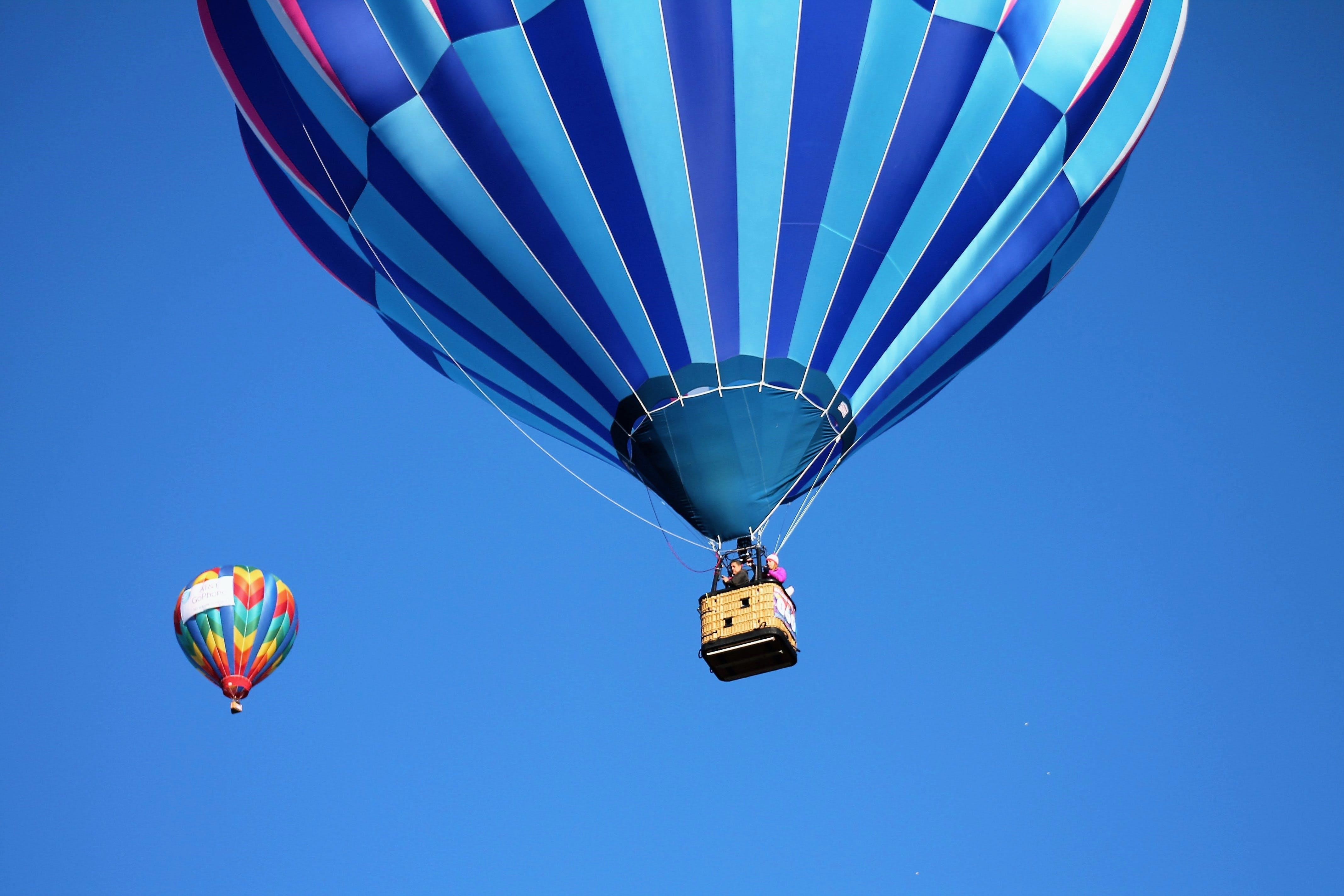 Blue and Teal Hot Air Balloon Near Pink and Blue Hot Air Balloon