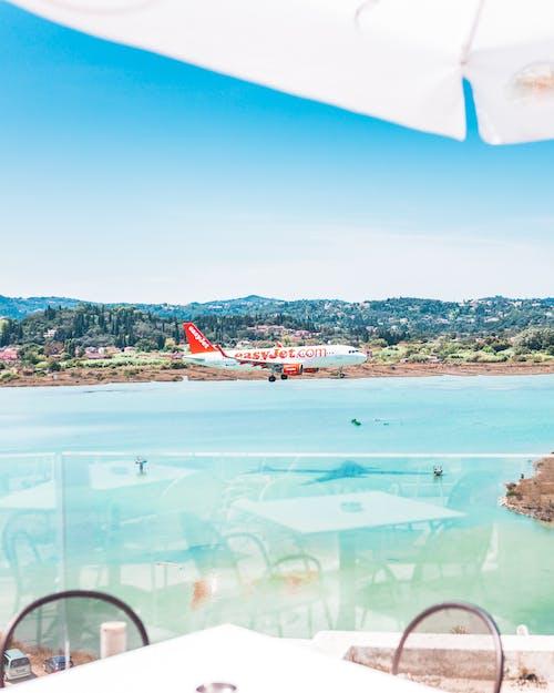 Photos gratuites de aéroport, atterrir, avion, bord de mer