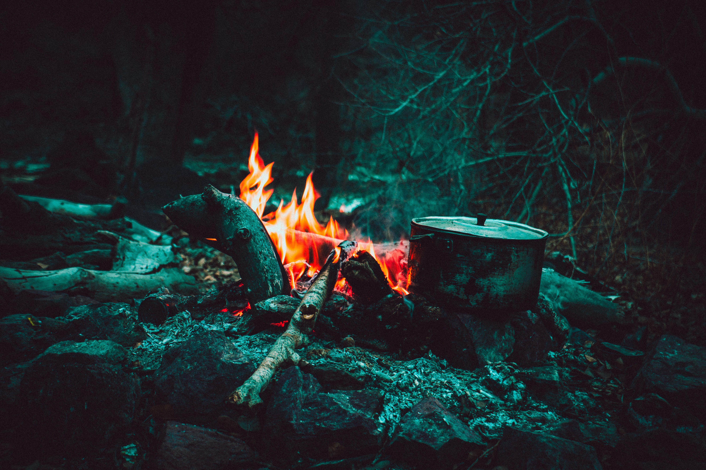 Cooking Pot Near Burning Wood