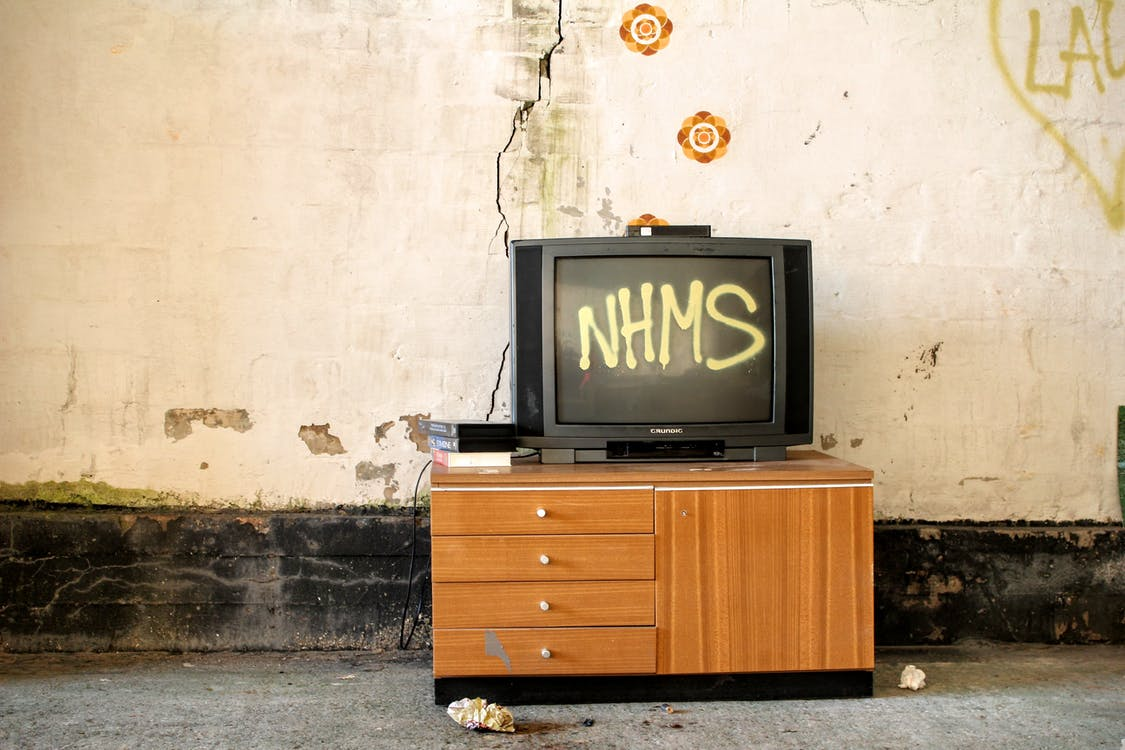 Black Crt Television Displaying Nhms