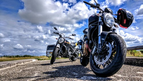 Black Sports Motorcycle Parked Beside Black Motorcycle