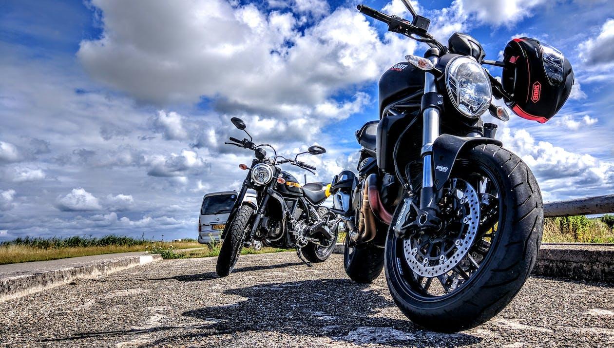 Black Sports Motorcycle Parked Beside Black Motorcycle