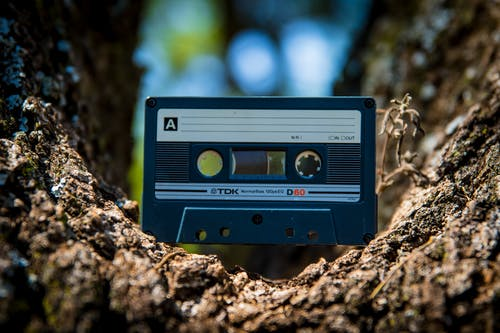Selective Focus Photography of Black Cassette Tape