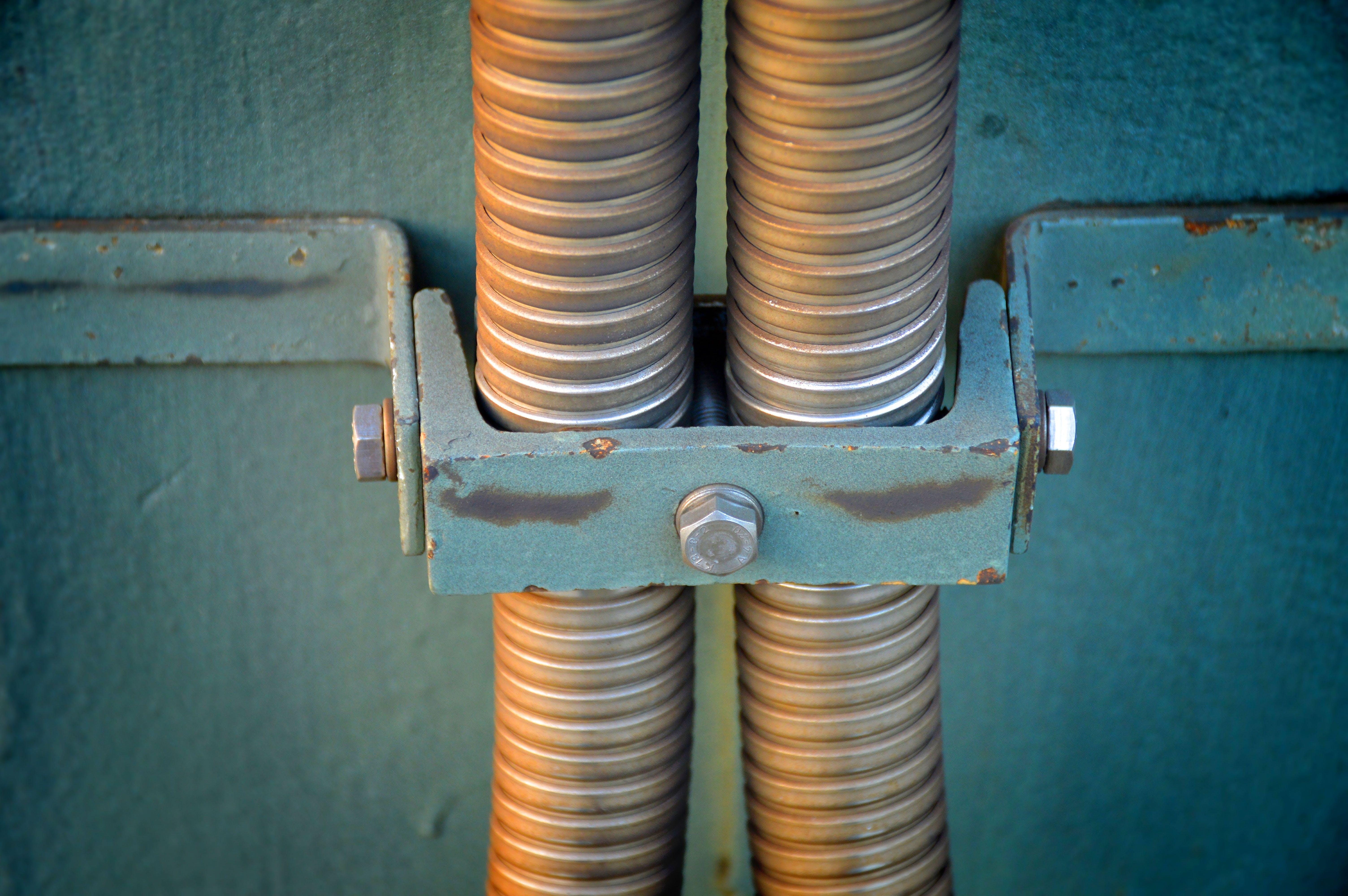Closeup Photo of Gray Pipes