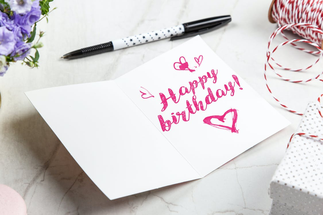 Open Birthday Greeting Card Near Pen