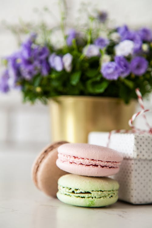 Macaroons Beside Gift Box