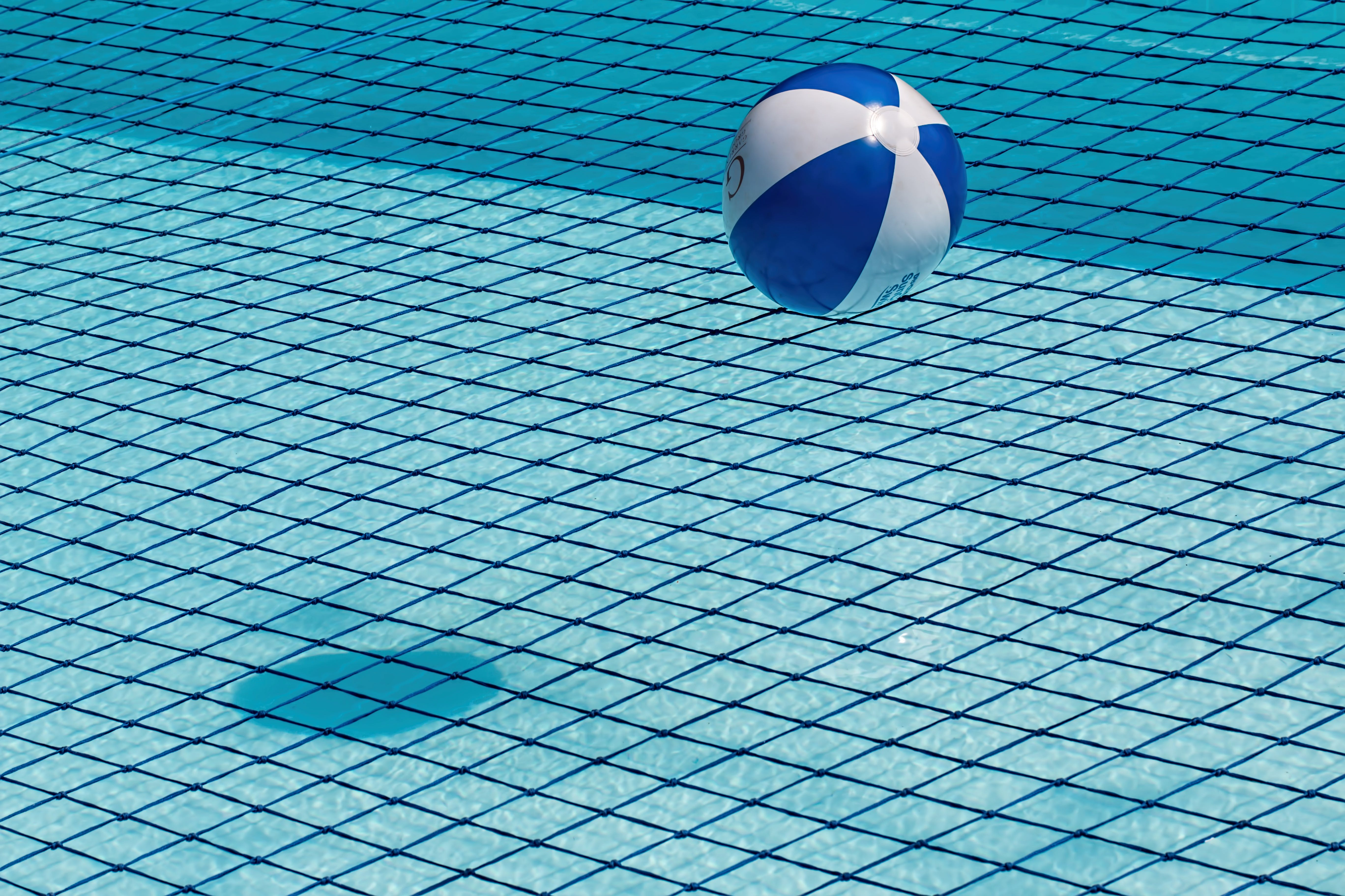 Blue and White Ball over Water