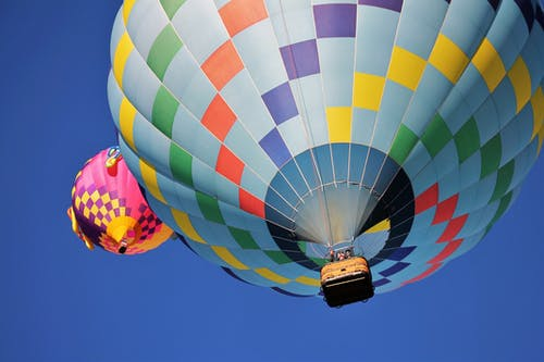 Blue and Multicolored Hot Air Balloon Under Blue Sky