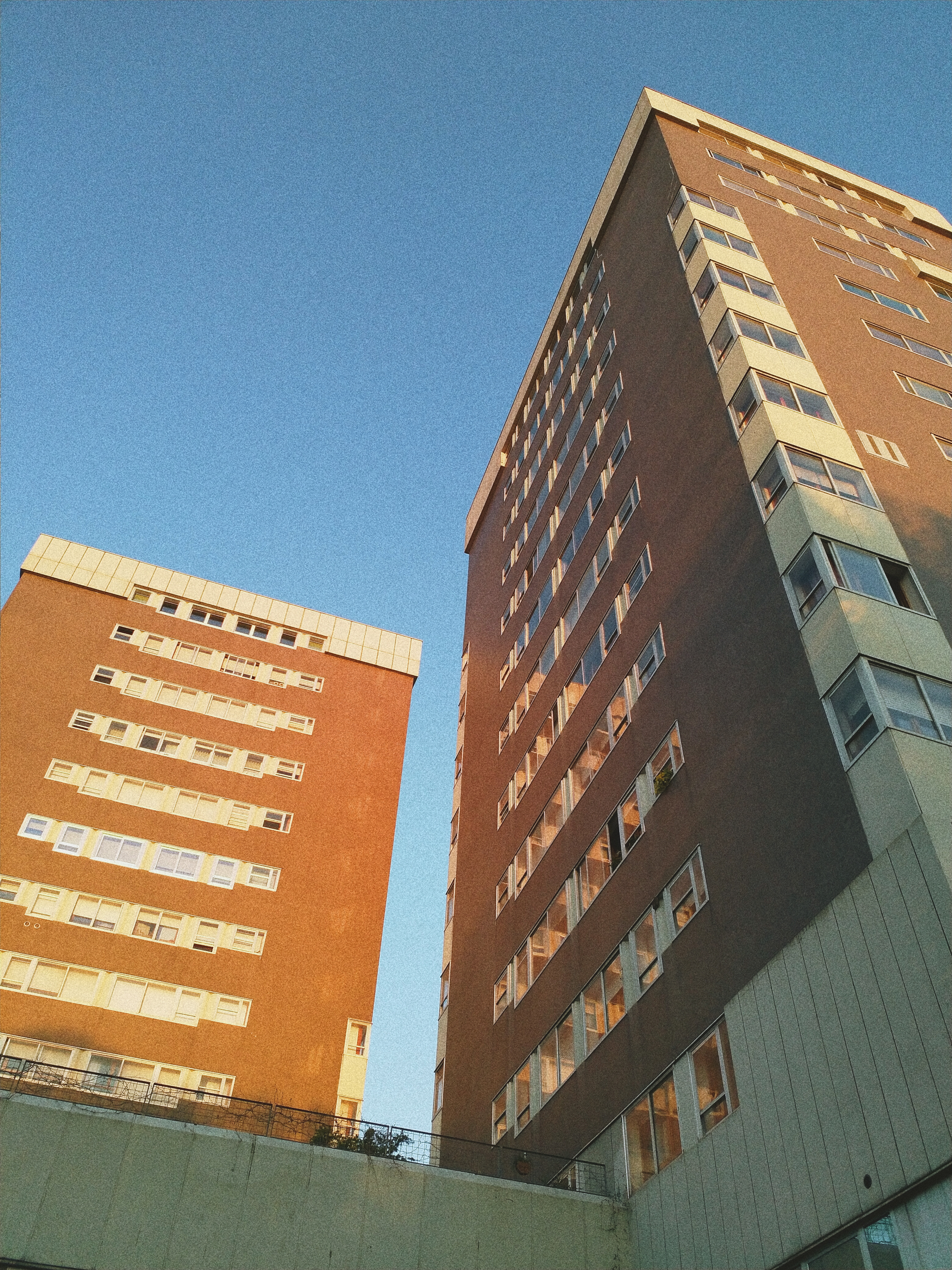 Low-angle Photography of Orange High-rise Buildings