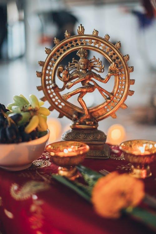 Shiva Nataraja Figurine Surrounded by Lighted Tealights