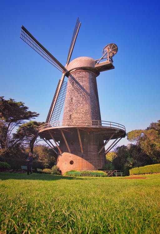 Person Standing With Windmill Background