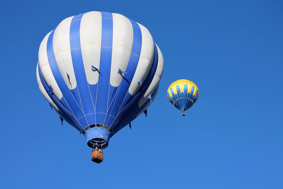 Two Blue and Yellow Hot Air Balloon