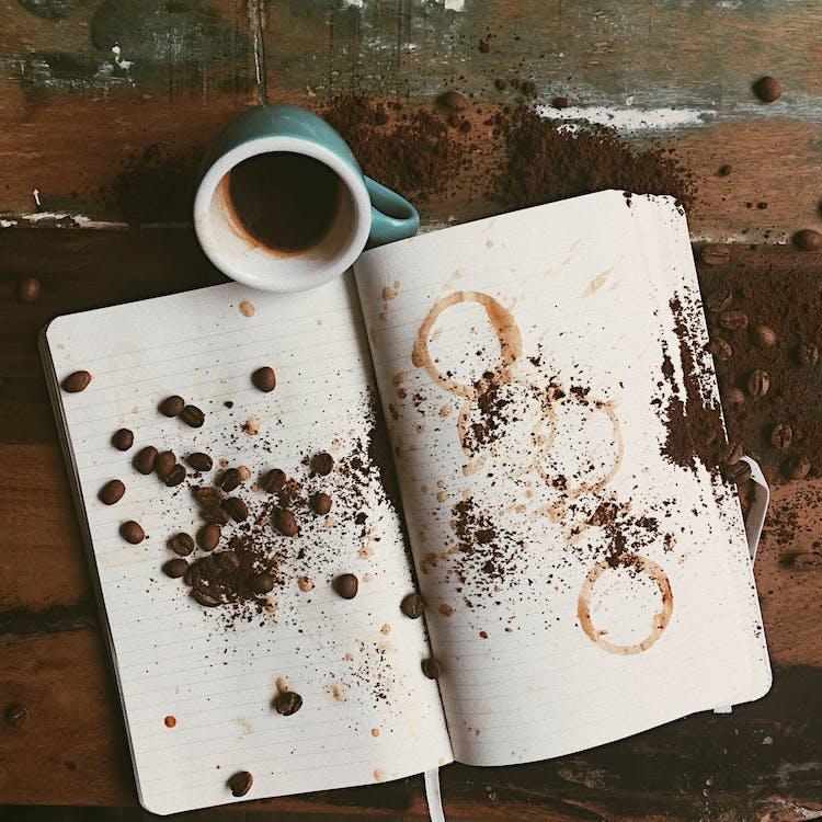 White Open Book and Blue Ceramic Mug