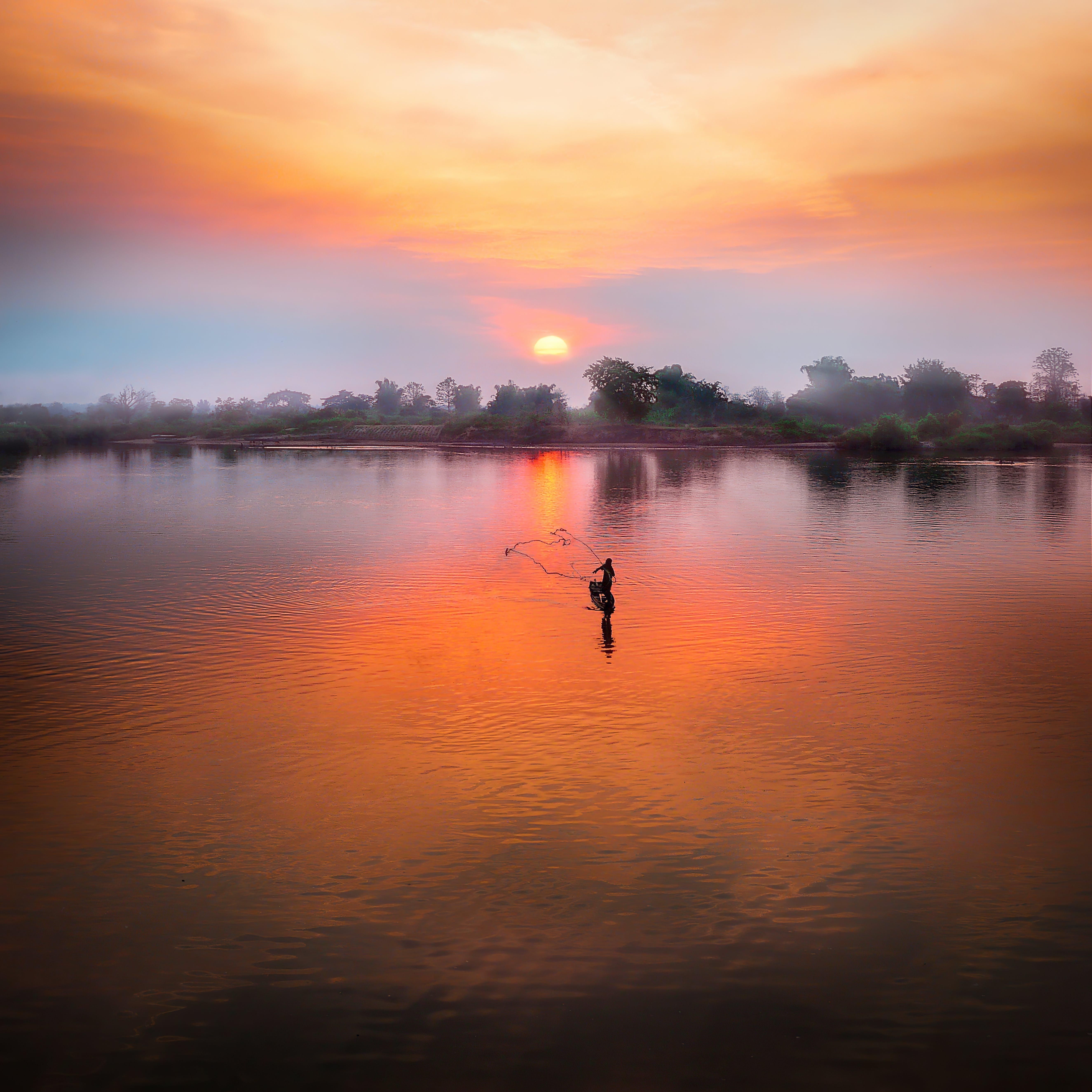 Photo of Lake During Sunseet