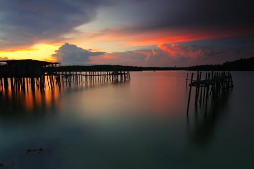 Kostenloses Stock Foto zu anlegesteg, dämmerung, himmel, seebrücke