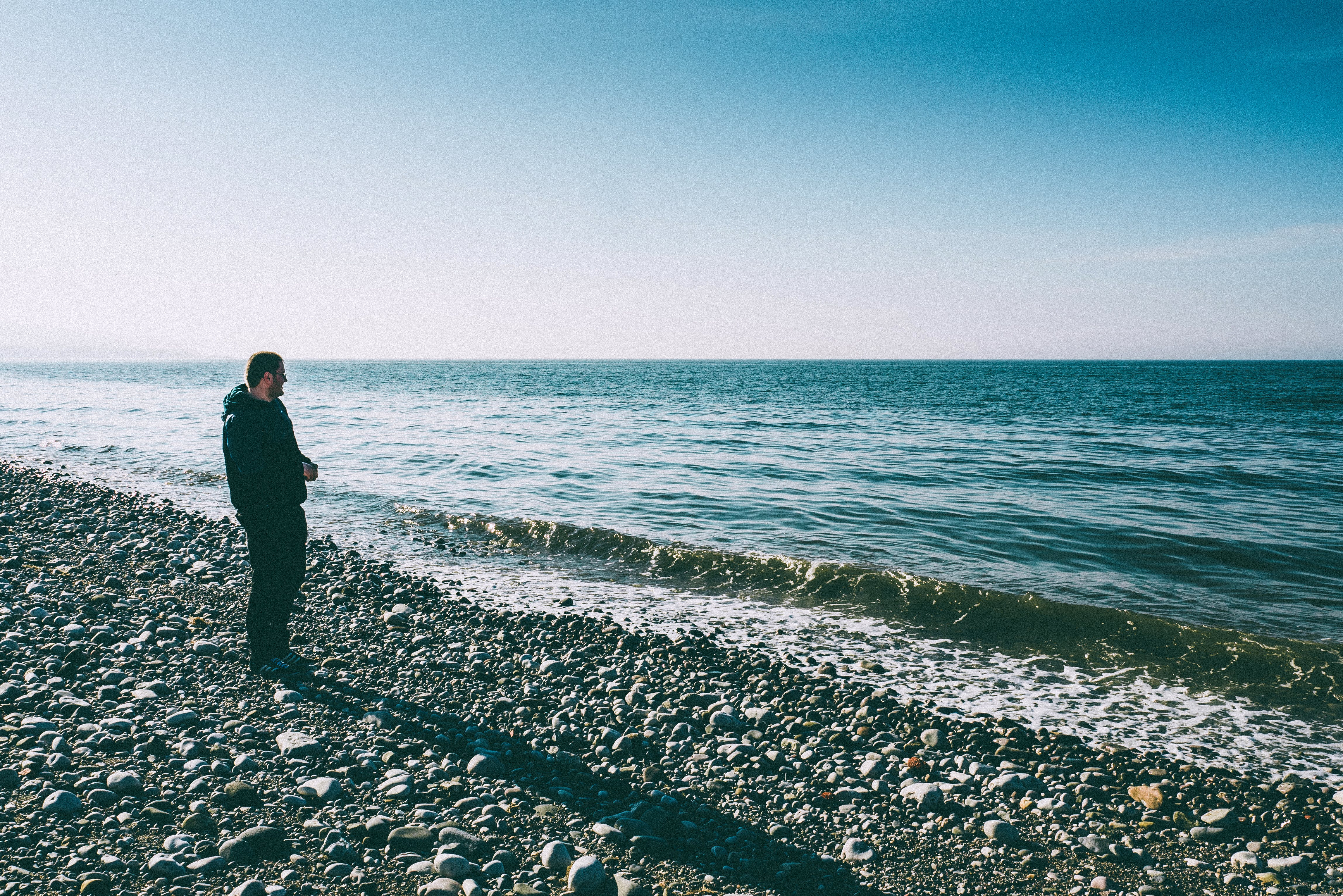 Man Standing Beside Shore
