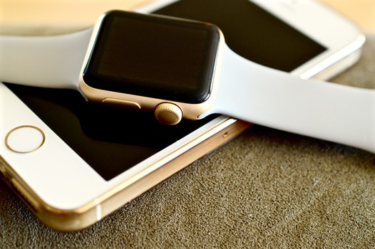White Sport Band Silver Apple Watch on Gold Iphone 5s