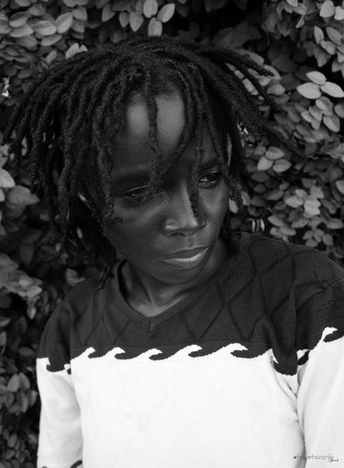 Grayscale Photo of Woman Wearing Dreadlocks