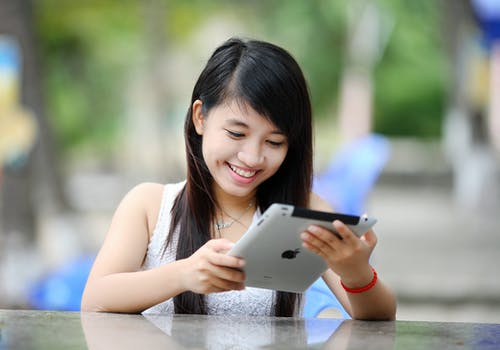 Woman Holding White Ipad