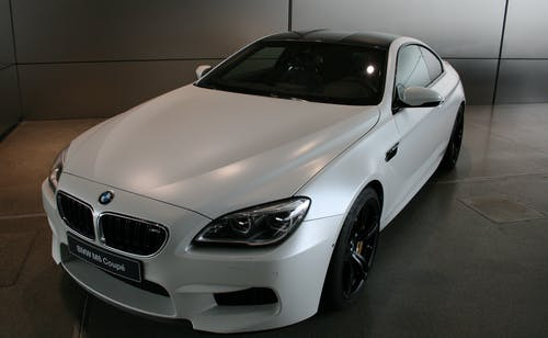 White Bmw Coupe Parked Inside Room