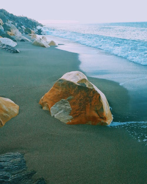Photography of Brown Rock Near Sea