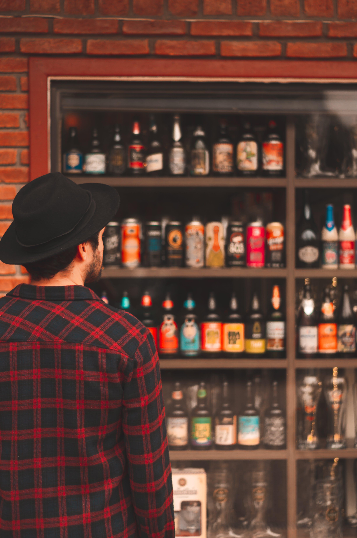 Man Looking at Liquor Bottles