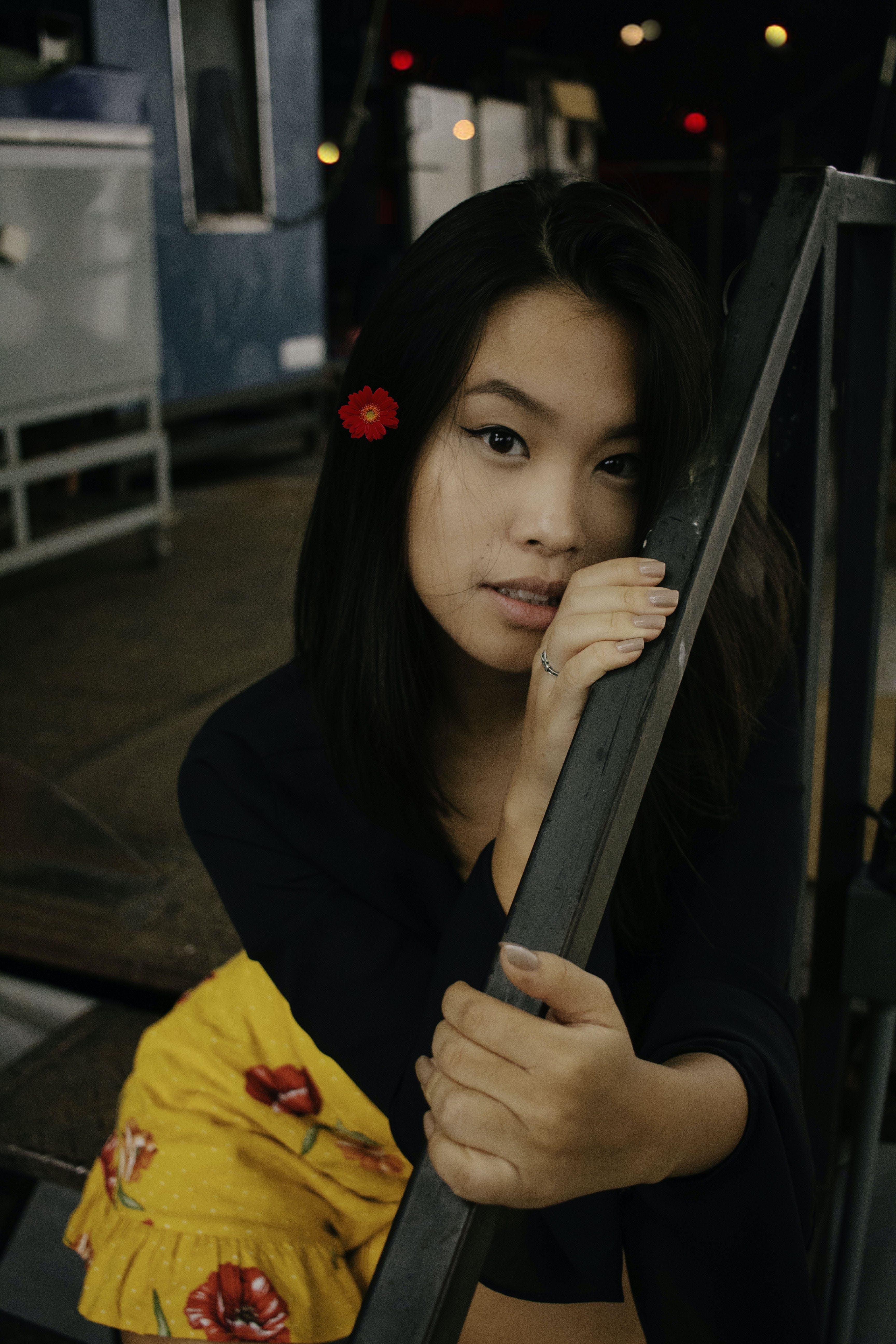 Woman Wearing Black Long-sleeved Shirt Holding Black Handrails