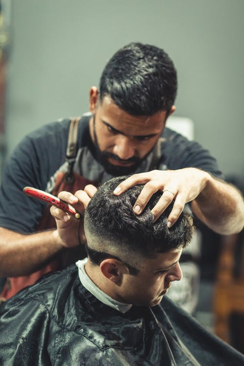 Barber Cutting Person's Hair