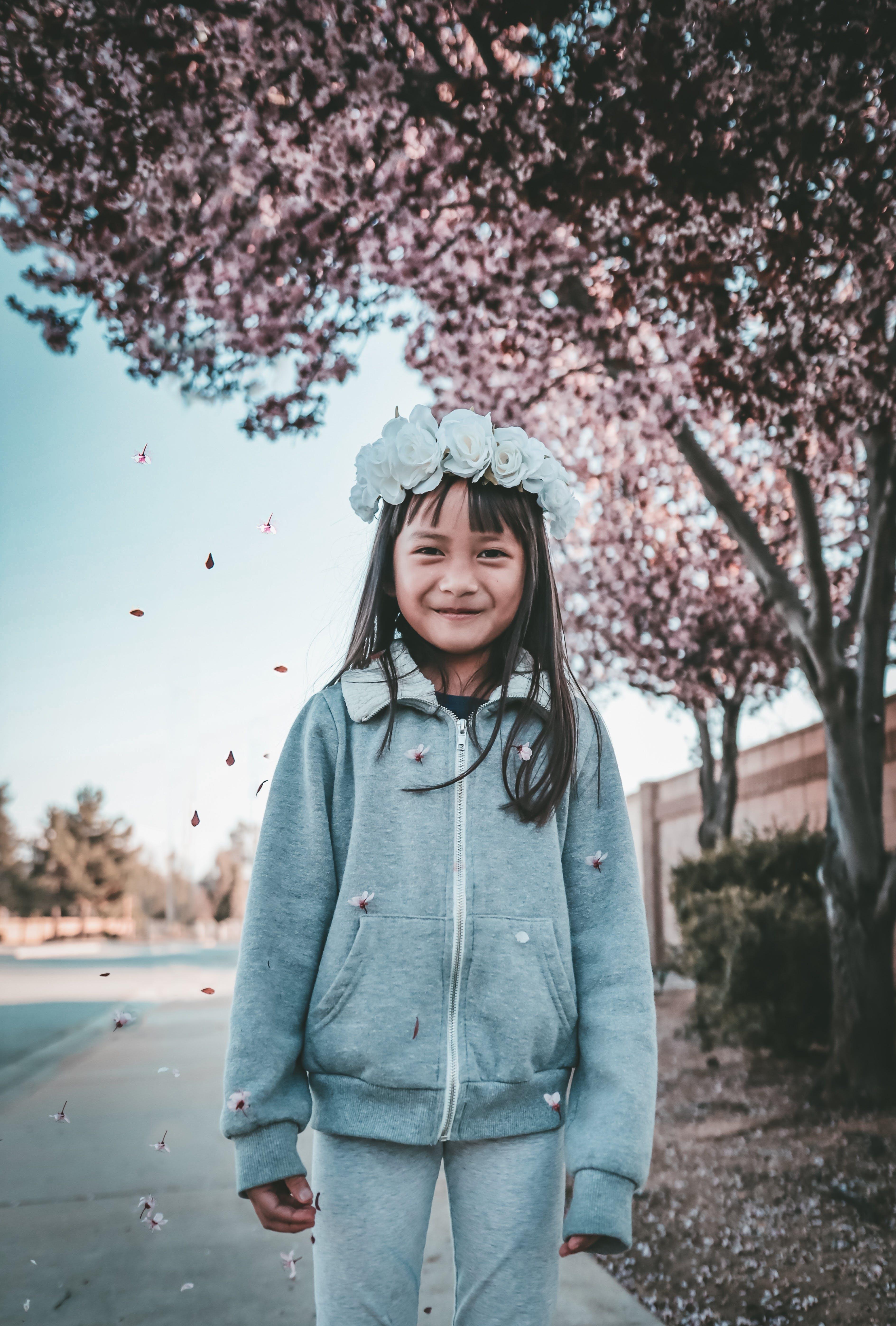 Girl Wearing Gray Zip-up Hoodie and Pants With Flower Tiara