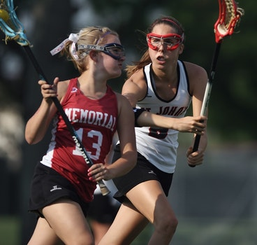 Woman and Girl Playing Lacrosse