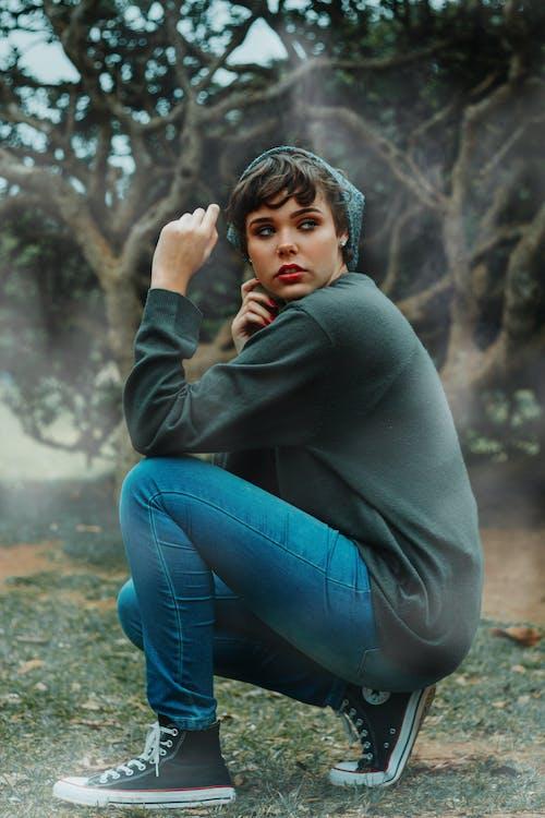 Sitting Woman Wearing Blue Denim Jeans