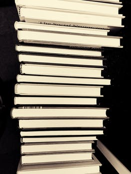 black and white book stack books education