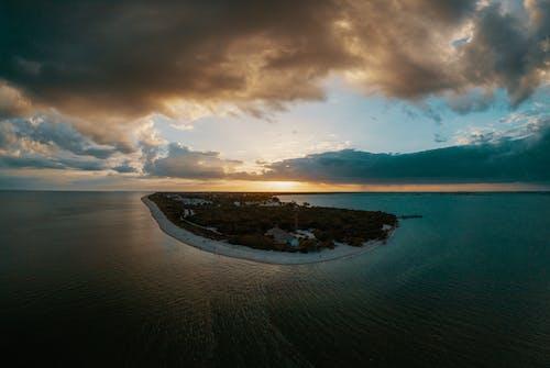 Island Under Cloudy Sky