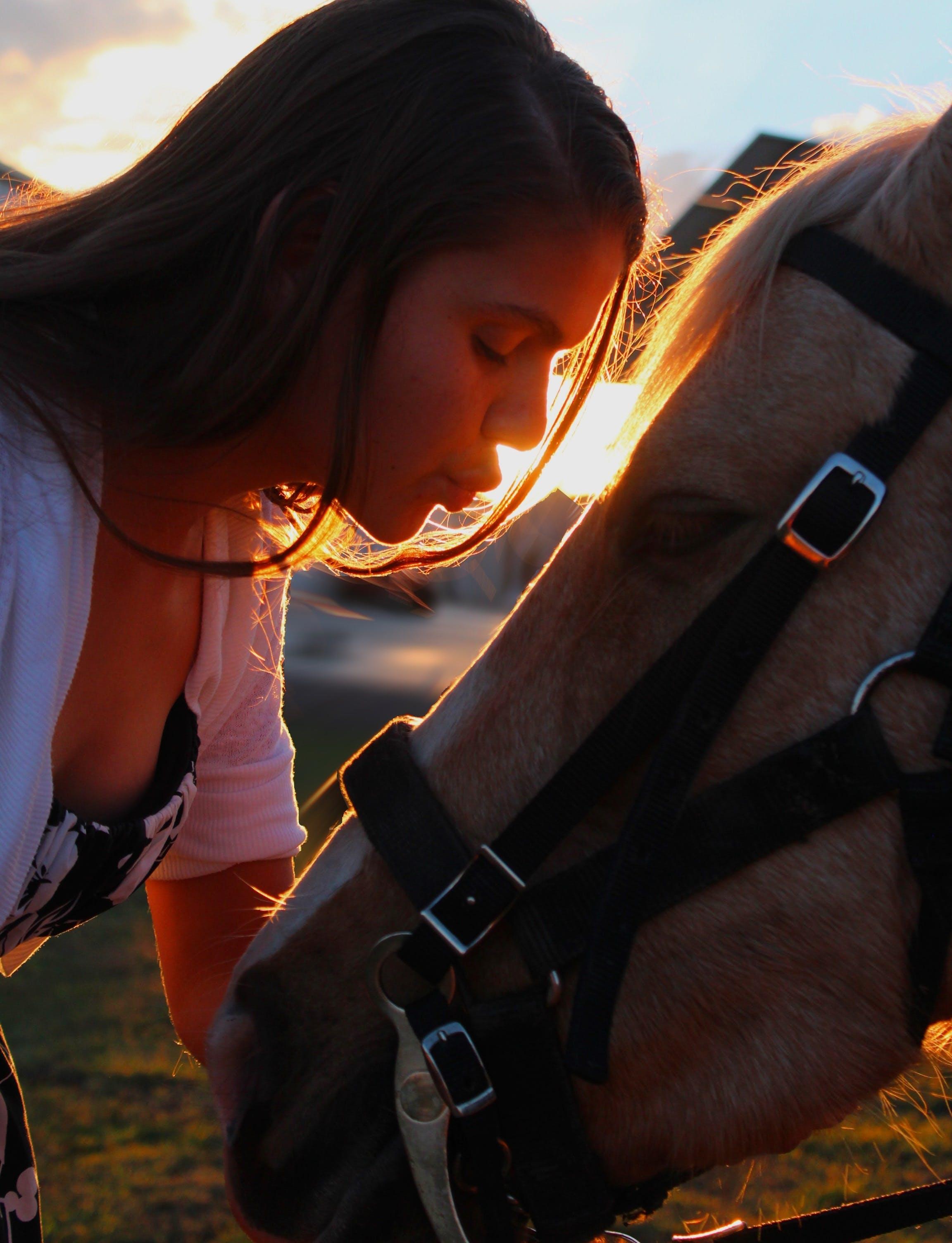 Woman Kissing Horse Head