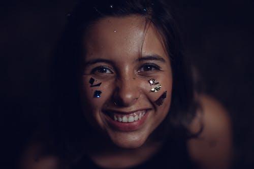 Person Smiling Wearing Black Tank Top