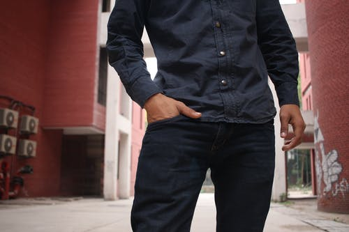 Person Wearing Black Sport Shirt and Black Jeans