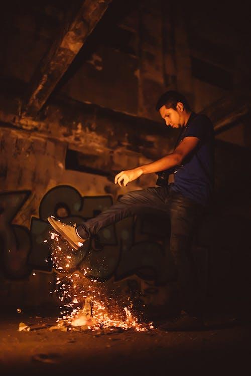 Man Kicking Bonfire