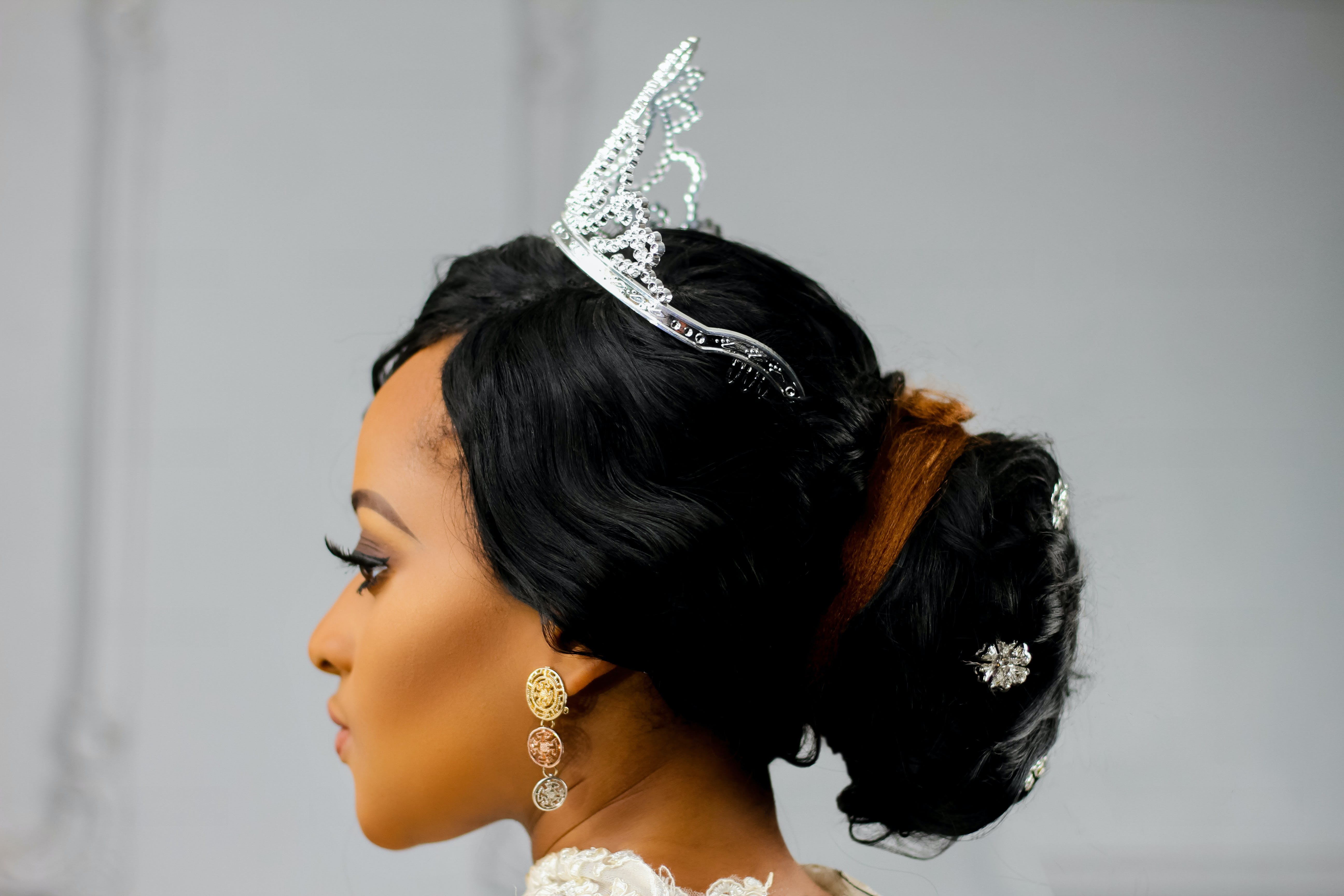 Woman Wearing Silver-colored Crown