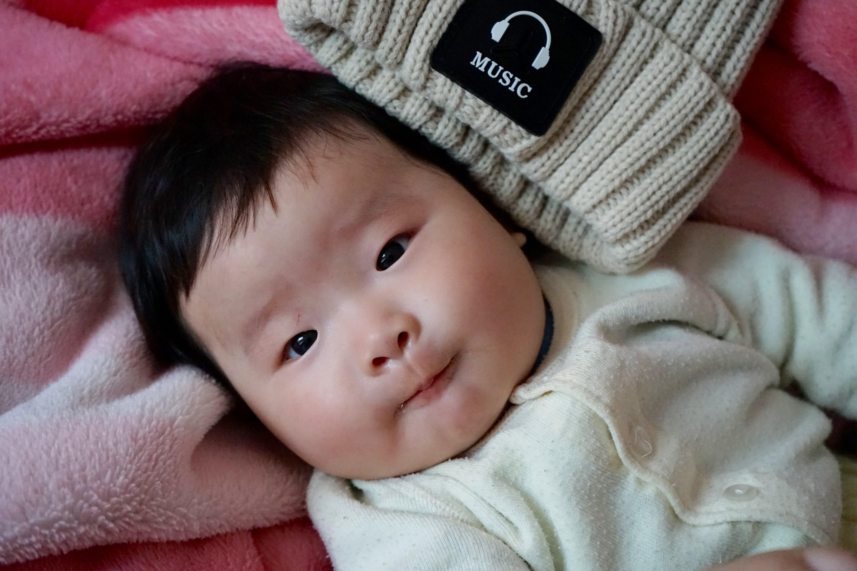 Baby Lies on Pink Towel