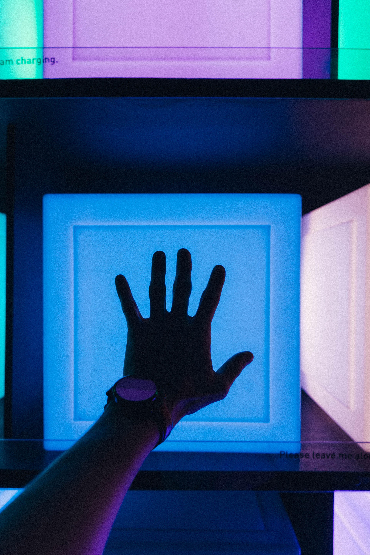 Left Person's Hand Near Blue Board