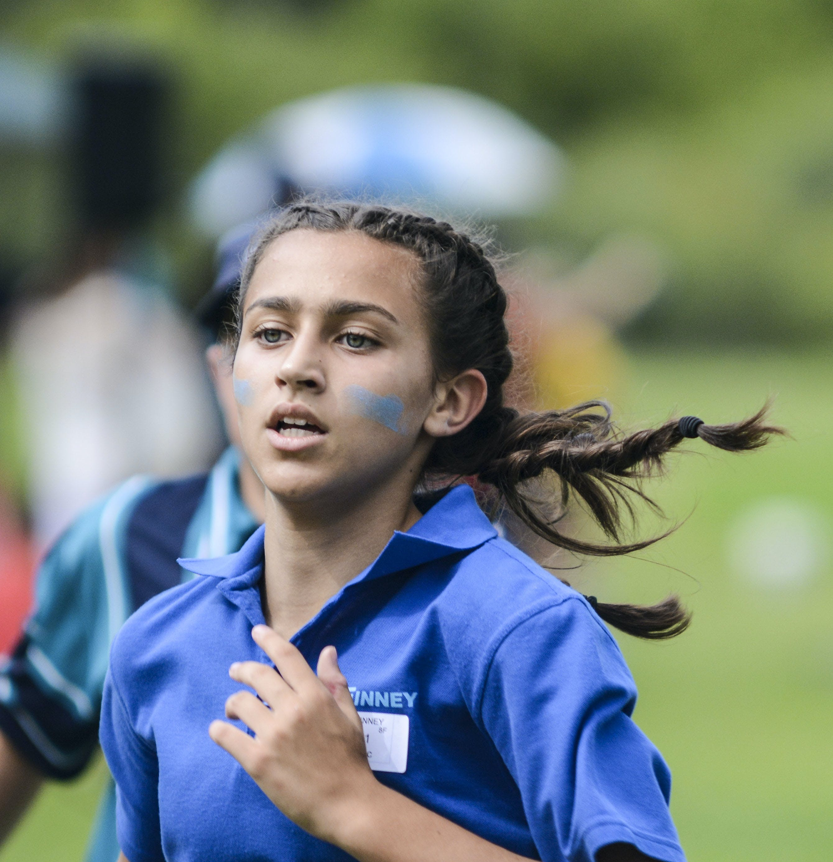Girl in Blue Polo Shirt Running