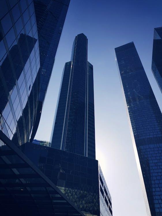 Blue Glass Paneled Buildings Under Clear Blue Sky