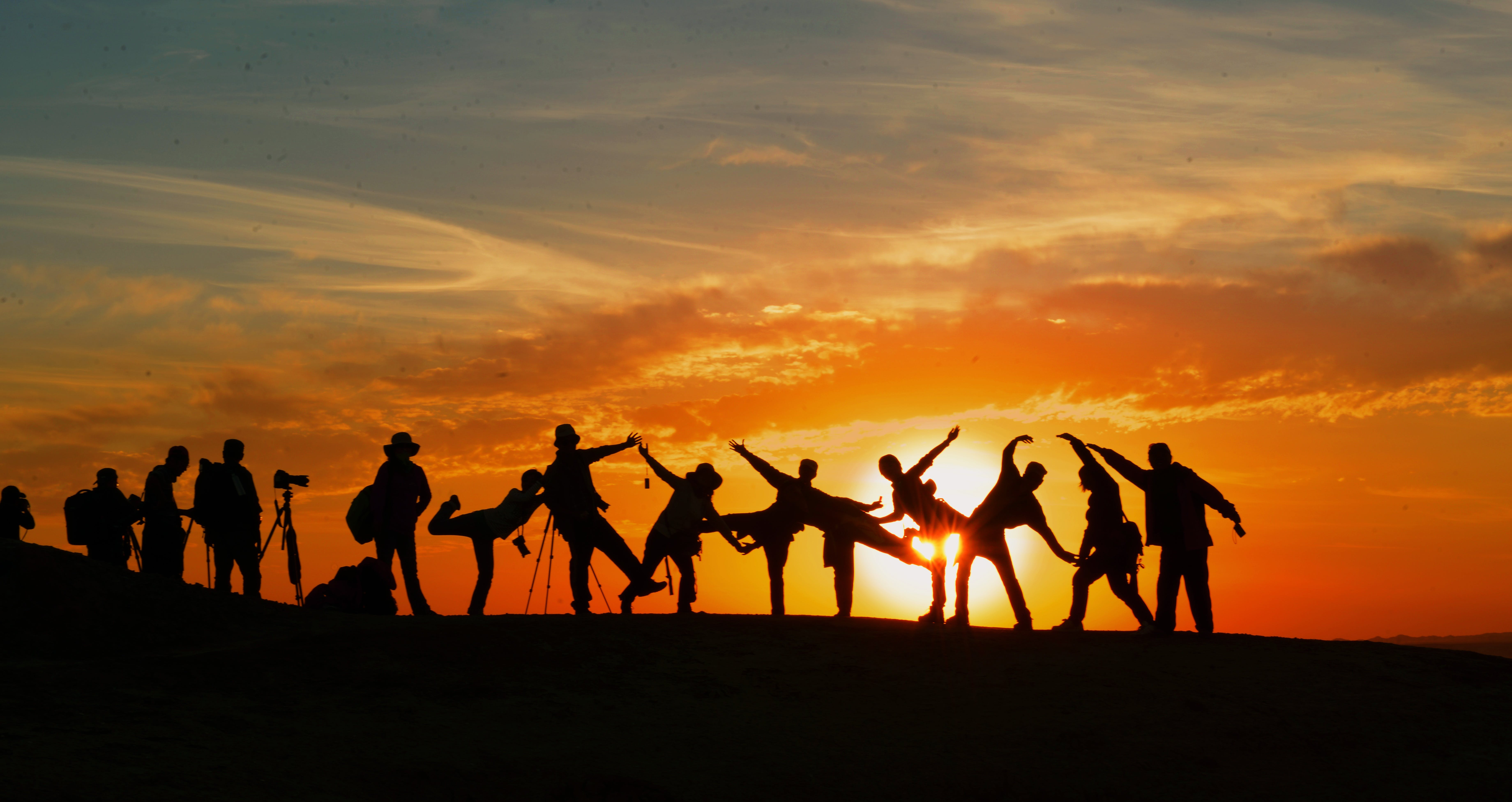 People posing in the sunset