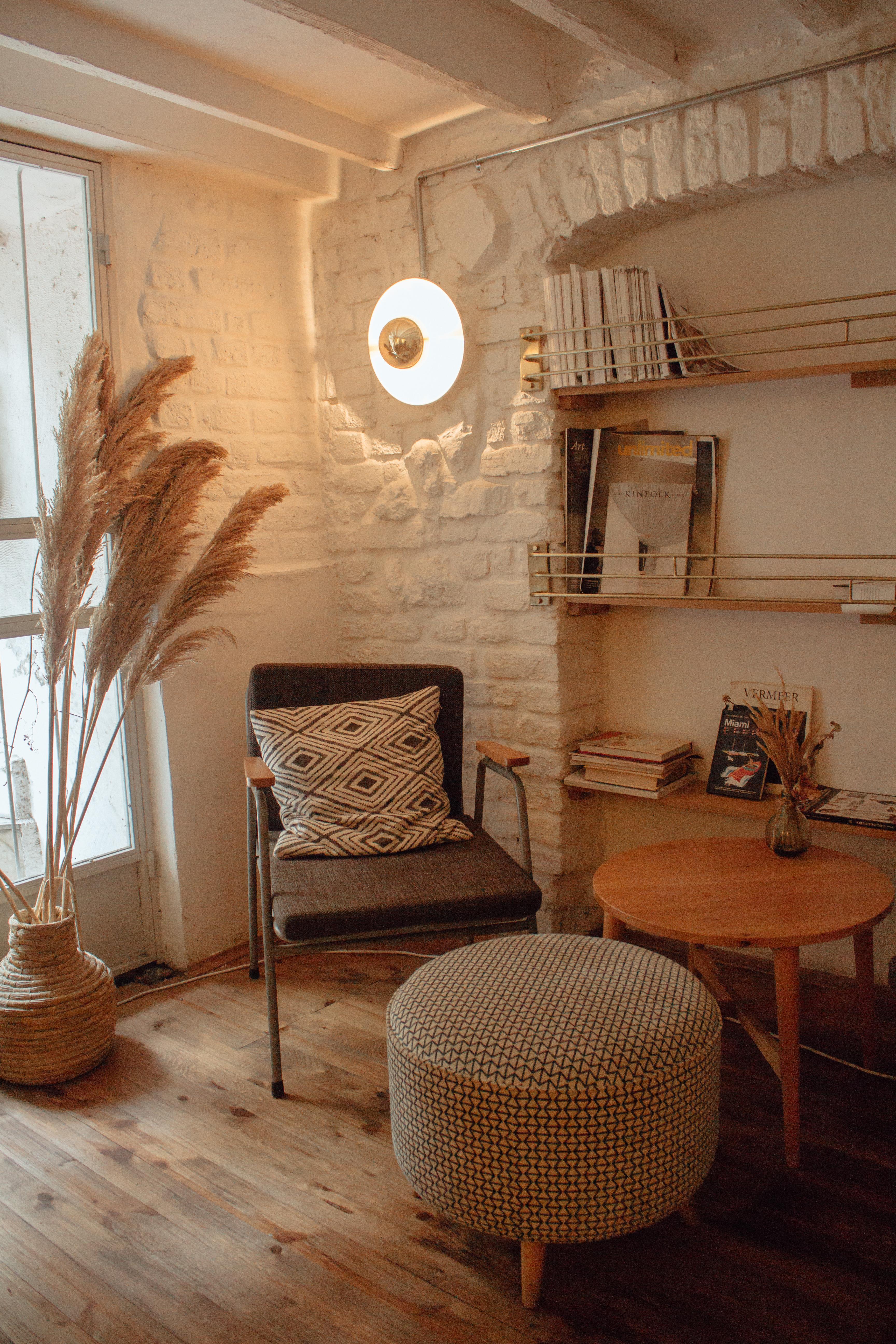 Armchair Near Table and Ottoman