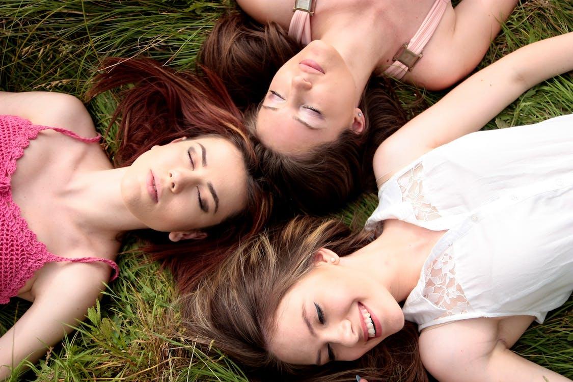 2 Women Lying on Green Grass