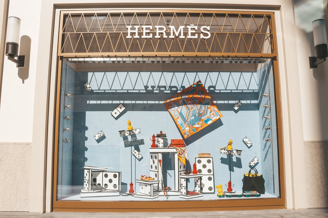 Opened Brown Gate Near Hermes Toys