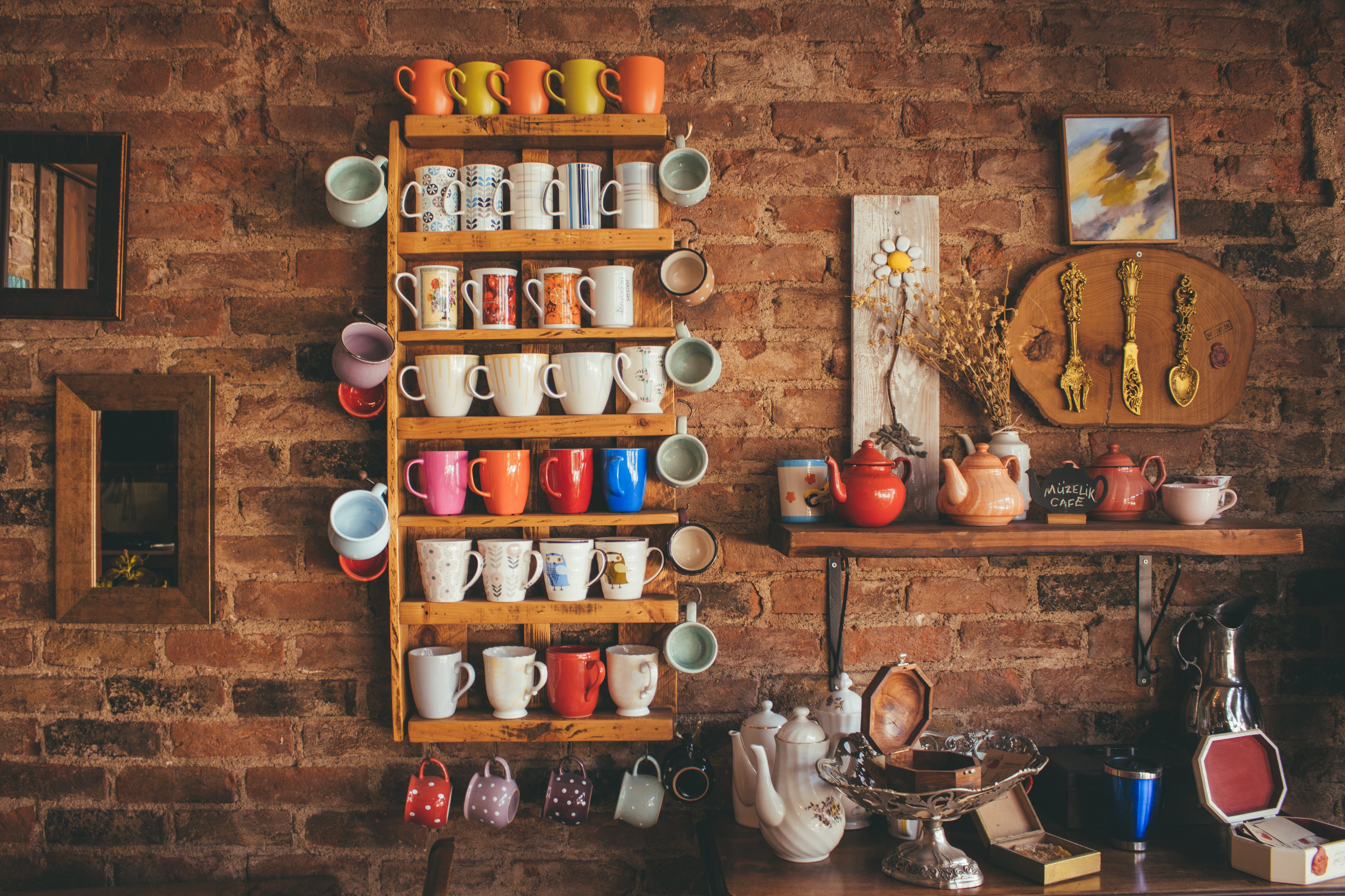 Assorted-color Mugs on Brown Wooden Floating Rack