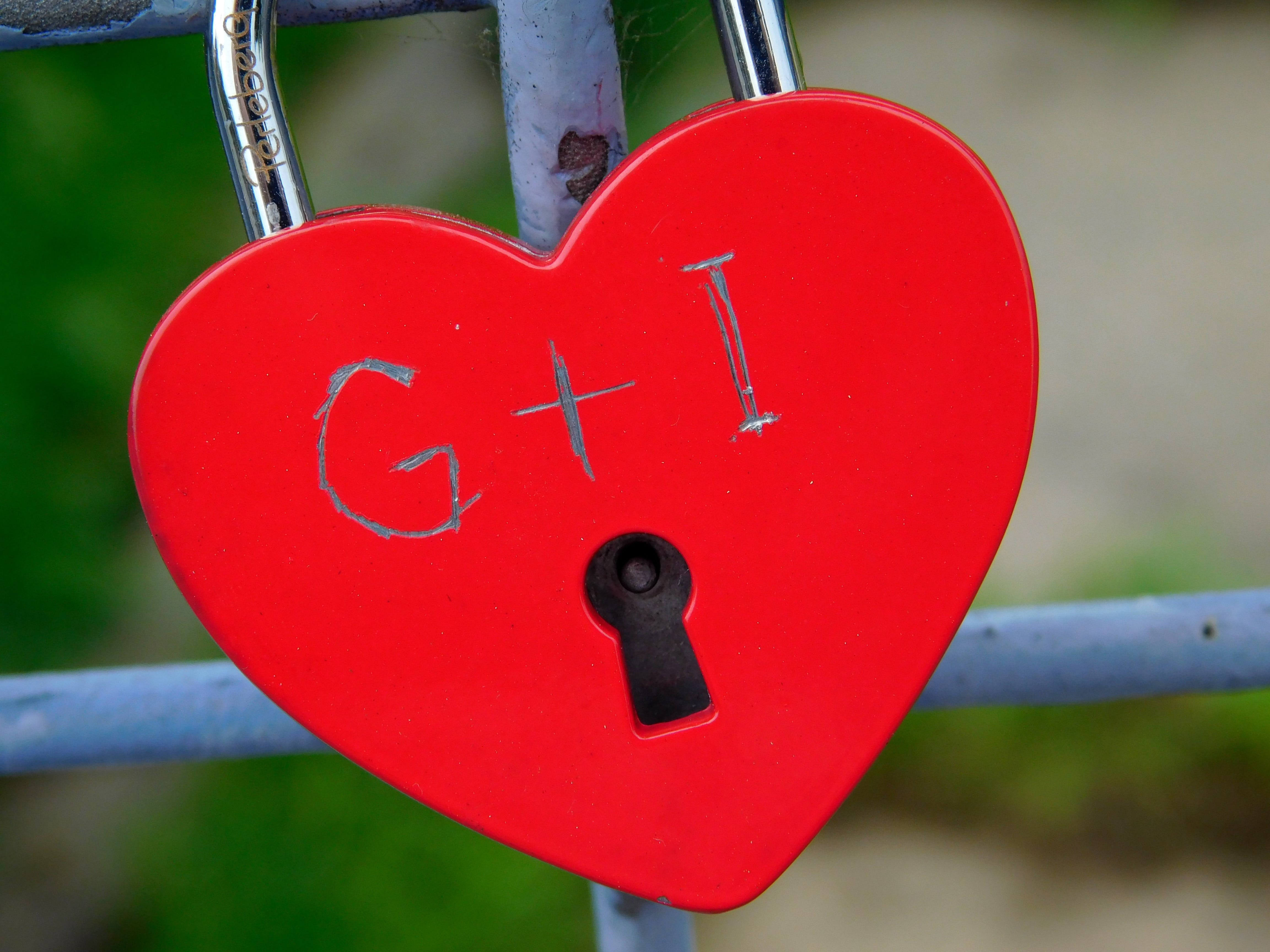 Heart-shape Red Padlock in Selective Focus Photography