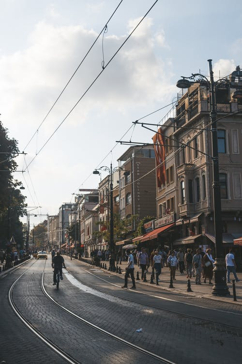 People Walking and Riding Bikes at the Streets during Day