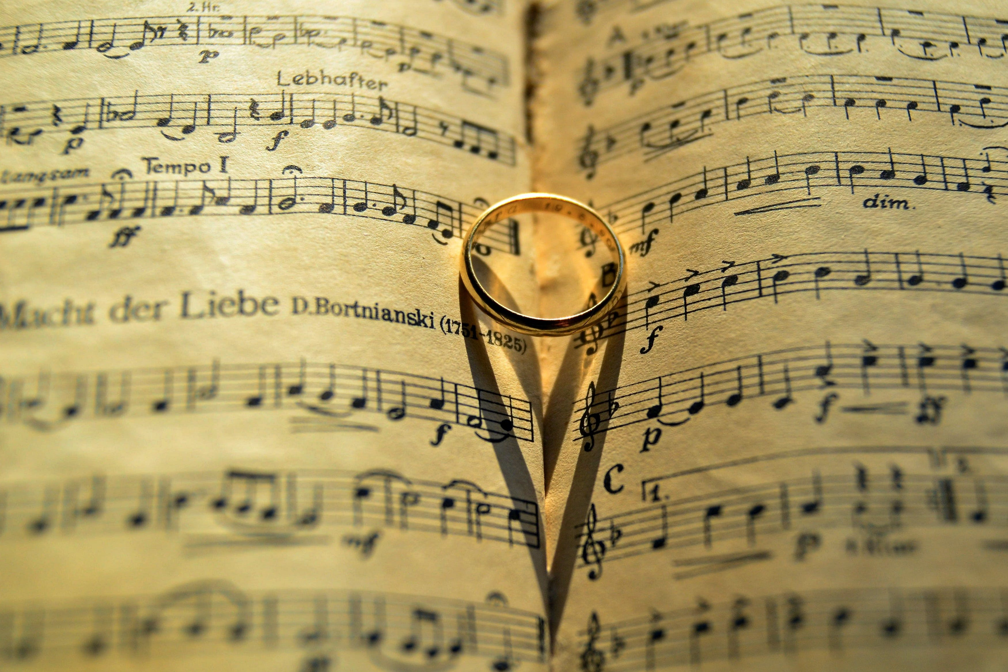Gold-colored Ring on Musical Note